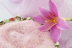 Pink lily flower with pink bath salt in decoupage decorated  bow Stock Photo