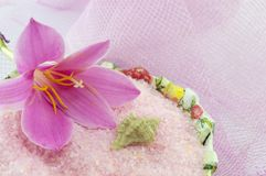 Pink lily flower with pink bath salt in decoupage decorated  bow Royalty Free Stock Image