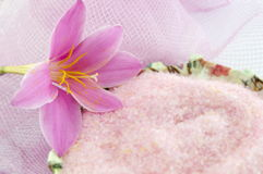 Pink lily flower with pink bath salt in decoupage decorated  bow Royalty Free Stock Photography