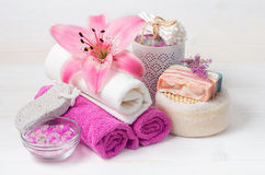 Pink lily flower,sea salt, towels,shoap and objects for spa pro Stock Photos