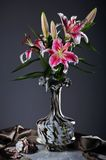 Pink Lily Flowers. Still life with pink  lily flowers  in a glass vase Royalty Free Stock Photo