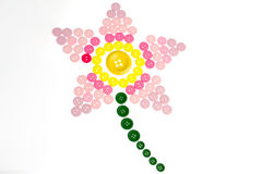 Pink lily made from sewing buttons. Kids drawing of a pink lily made from colourful sewing buttons Stock Photography