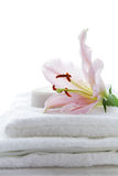 Pink lily, soap and towel Stock Photography