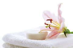Pink lily, soap and towel Stock Photo