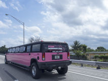 Pink limousine. On the US 1 highway. US 1 highway to Key West seen at Miami. U.S. Route 1 (US 1) is a major north–south U.S. Highway that serves the East Stock Images