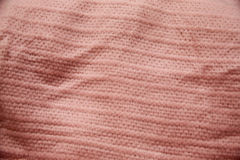 Pink Lined Patterned Cloth. Pink patterned cloth with ridges woven into the cloth Royalty Free Stock Photography