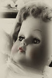Pink Lip Baby Doll. Antique porcelain girl baby doll with colorized red lips and tender eyes in black and white format stock images