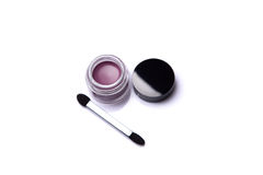 Pink lip gloss in jar with brush Stock Images