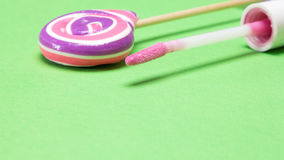 Pink lip gloss and lollipop with copy space Stock Image
