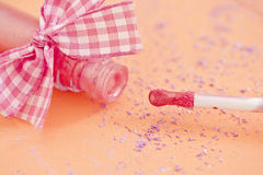 Pink lipgloss and decorative ribbon Royalty Free Stock Photo