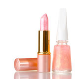 Pink lipstick and beige nail polish Stock Photo