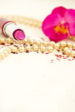 Pink lipstick and necklace with copyspace Royalty Free Stock Image