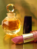 Pink lipstick and perfume Royalty Free Stock Photo