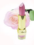 Pink lipstick with rose flower on background Royalty Free Stock Photos