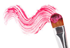 Pink lipstick stroke (sample) with makeup brush royalty free stock photo