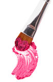 Pink lipstick stroke (sample) with makeup brush Royalty Free Stock Photos