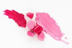 Pink lipstick texture, damaged cosmetic, flat lay Stock Photos