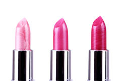 Pink lipsticks on white Royalty Free Stock Photography