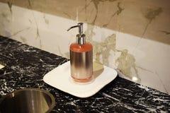 Liquid soap bottle for hand wash on Bathroom sinks. Pink liquid soap bottle for hand wash on Bathroom sinks stock photo