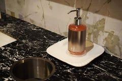Liquid soap bottle for hand wash on Bathroom sinks. Pink liquid soap bottle for hand wash on Bathroom sinks stock photos