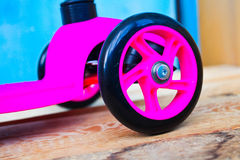 pink little kid scooter Stock Images