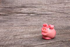 Pink little luck pig at new year on wood Royalty Free Stock Photography