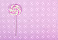 Pink lollipop. Pink paper background. Pink polka dot background. royalty free stock photography