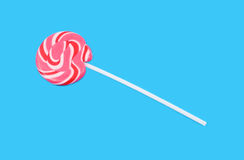 Pink lollypop. Isolated on bright blue Royalty Free Stock Image