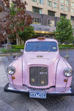 Pink London Taxi of Langham Hotel Royalty Free Stock Photos