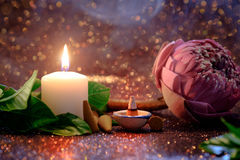 Pink lotus flower folding thai style with white candle light and. Incense thai aroma stick  with red bokeh background for pray or meditation caption and aroma Stock Photos