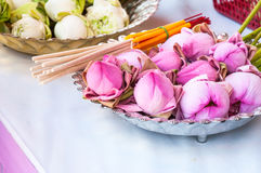 Pink Lotus flower, incense sticks and candles set for praying buddha. At temple stock images