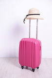 Pink luggage case with wall. Pink luggage case with white wall background Stock Photo