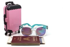 Pink luggage, Thai passport with banknotes and fashion sunglasse royalty free stock photos
