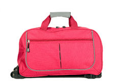 Pink luggage with wheels. For travel purposes Royalty Free Stock Photos