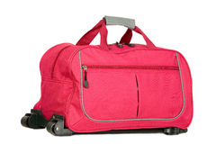 Pink luggage with wheels. For travel purposes Stock Photography