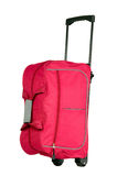 Pink luggage with wheels. For travel purposes Stock Photos