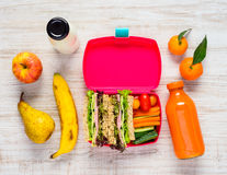 Pink Lunch Box with Tasty looking Fruits and Vegetables stock image