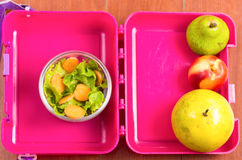 Pink lunchbox with healthy food fruits and Stock Photography