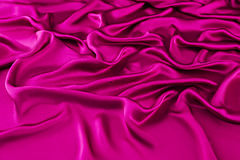Pink luxurious silk, wavy fabric. Abstract background luxury cloth or liquid wave or wavy folds of grunge silk texture satin velvet material or luxurious Royalty Free Stock Image