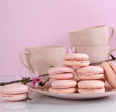 Pink macaron cookies with vintage cups Royalty Free Stock Image