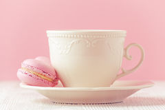 Pink macaron homemade and a cup of coffee on pink background toned Stock Photos