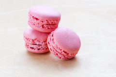 Pink macaron on wooden background Royalty Free Stock Photo