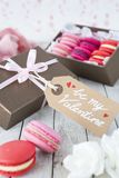 Pink macarons in a box for Valentine`s Day royalty free stock image