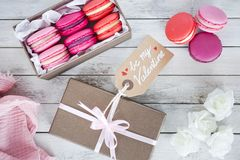 Pink macarons in a box for Valentine`s Day stock photos
