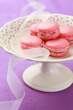 Pink macarons on cake stand Royalty Free Stock Photography