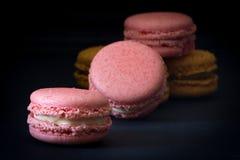 Pink Macarons on Dark Background Royalty Free Stock Photos