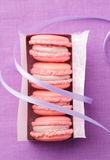 Pink macarons in gift box with ribbon Royalty Free Stock Image