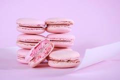 Pink macarons petit fours cookies. Close up on pink background Stock Photos