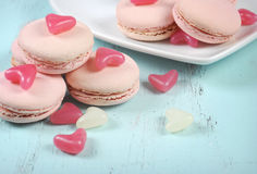 Pink macarons with pink and white jelly candy hearts Stock Image