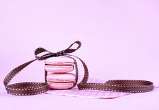 Pink macarons tied with ribbon Royalty Free Stock Photos